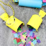 Yellow homemade party popper spilling confetti onto the counter