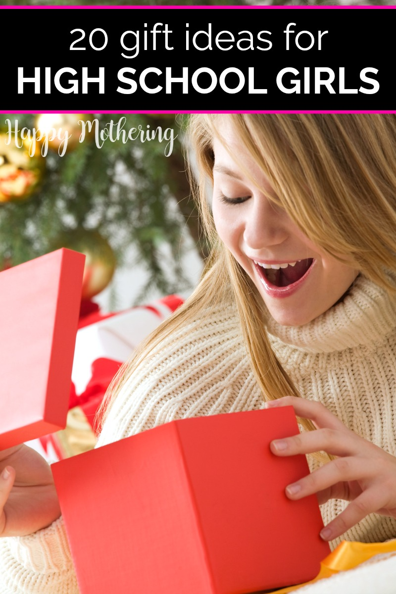 High school girl with blond hair opening gift on Christmas day