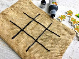 Paint a tic tac toe board onto the bag with puffy paint.