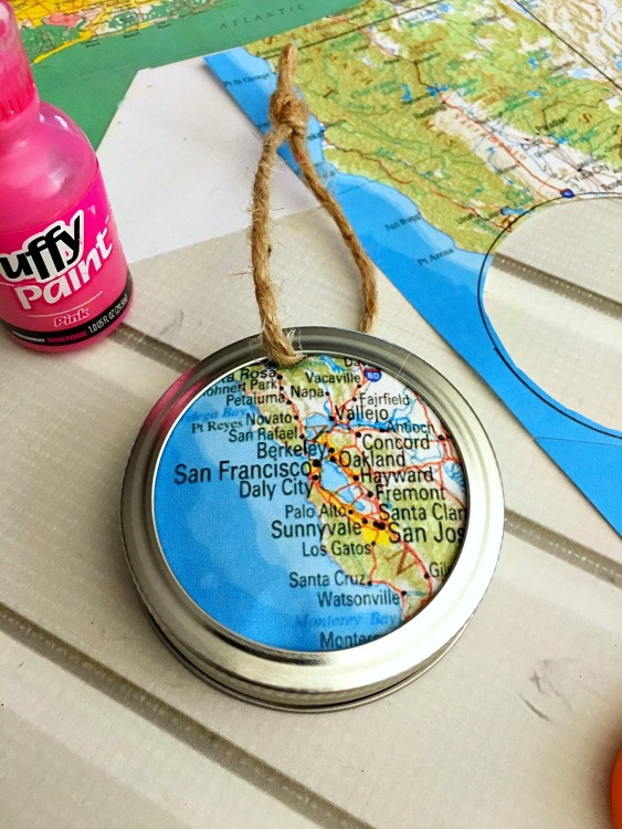 glue the map into the mason jar ring