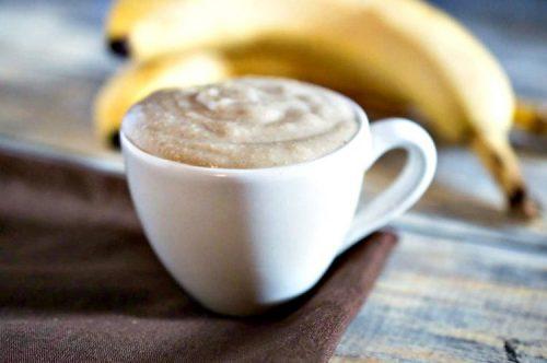 Banana Oat Face Mask in a coffee mug with a banana