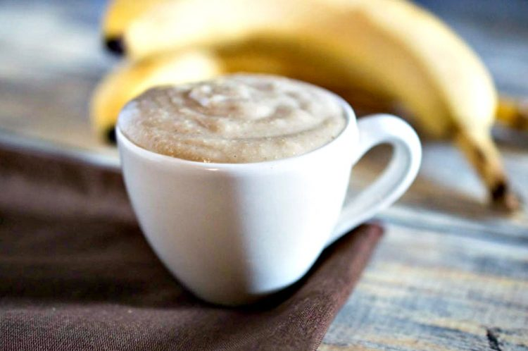 Banana Oat Face Mask in a coffee mug with a banana