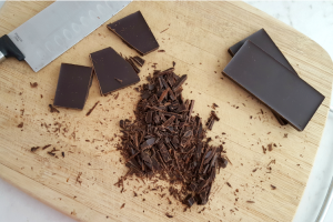 Chocolate bar chopped on a cutting board
