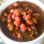 Close up of Bean Soup in a white bowl that was made in a pressure cooker