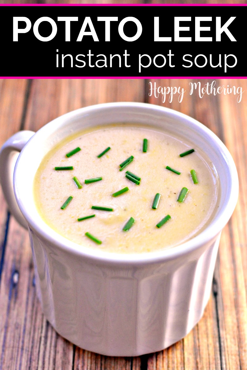 White soup bowl full of Instant Pot Potato Leek Soup garnished with green chives