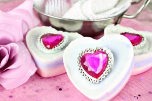 Finished Valentine's Day Ring soap bars on a pink table setting