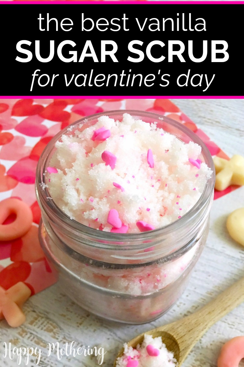 White sugar scrub with pink hearts in a glass jar on a white wood table with heart tissue paper