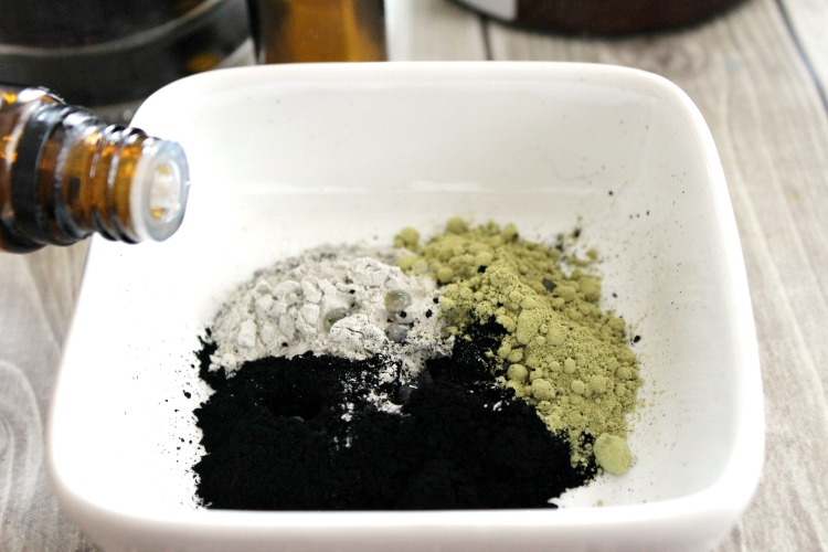Activated charcoal face mask ingredients in a bowl