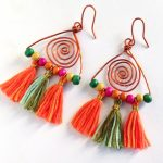 A pair of cute dangle boho earrings on white background
