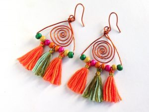 A pair of cute dangle boho earrings on white background
