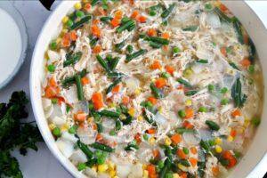 Ingredients for chicken pot pie casserole in a saucepan