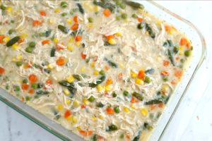 Gluten free chicken pot pie casserole mixture in a baking dish prior to adding crust topping.