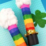 Two rainbow shaker wands with clouds made as a St. Patrick's Day kids craft