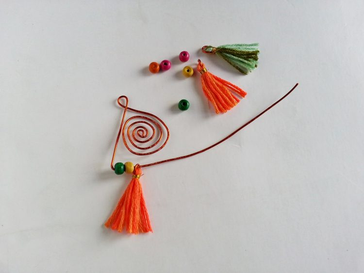 Adding beads and tassels to copper wire