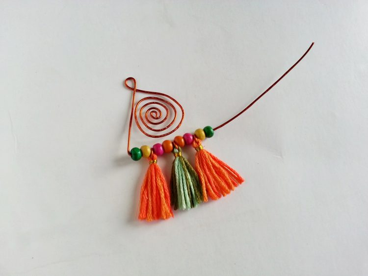 Beads and three tassels on copper wire