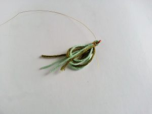 Golden thread tying the embroidery floss