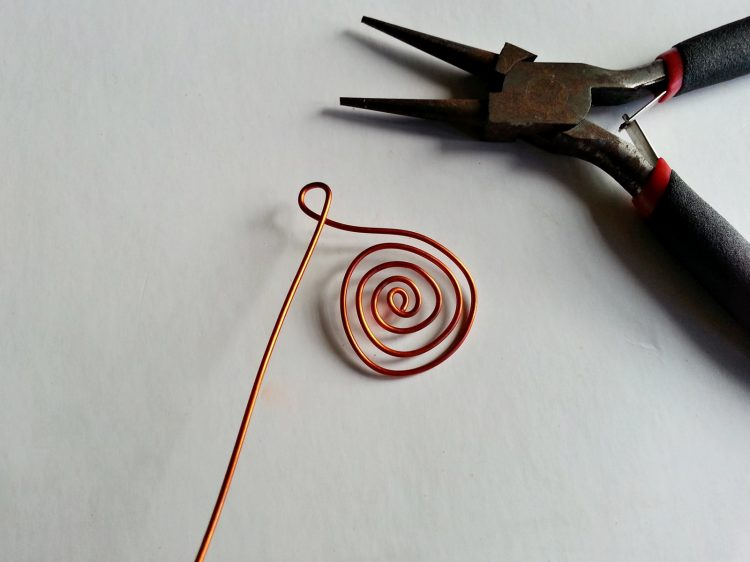 Copper twirl with loop at top