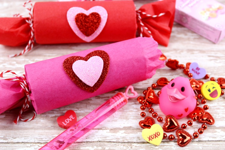 Are you looking for a cute Valentine's Day craft for kids as an alternative to traditional cards? These DIY Treat Poppers are easy to make with upcycled toilet paper rolls and candy or toys.