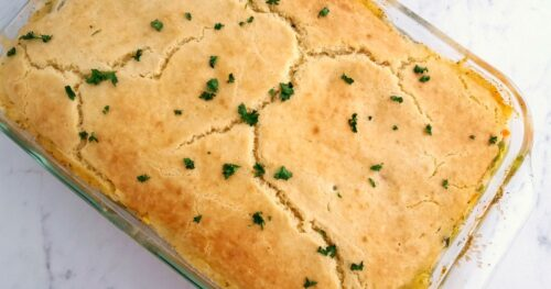 Large glass dish with baked chicken pot pie casserole