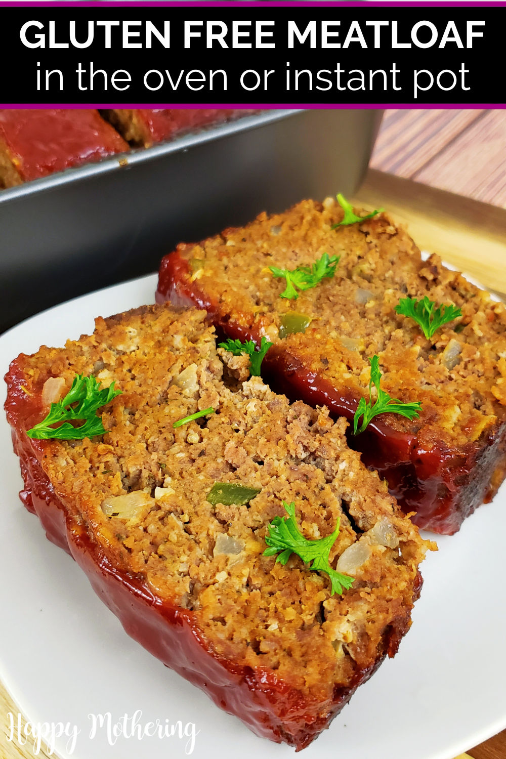 2 slices of gluten free meatloaf on a plate next to the loaf pan on the table.