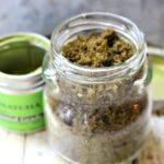 Jar of brown sugar body scrub with matcha green tea powder added