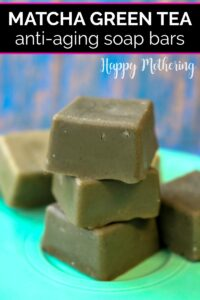 Green tea soap bars stacked on a teal plate
