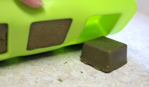 Popping the matcha green tea soap bars out of the silicone mold