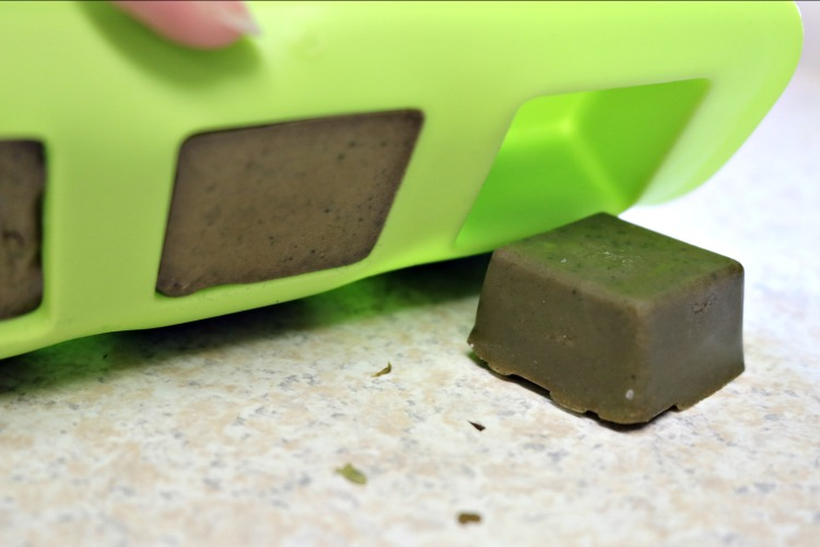 Popping the matcha green tea soap bars out of the silicone mold.