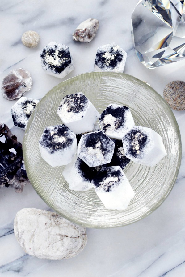 Making your own DIY soothing bath fizzies with natural ingredients is easy! This recipe goes beyond the typical bath bomb recipe with baking soda, citric acid powder and essential oils, and includes activated charcoal and shimmering mica powder.