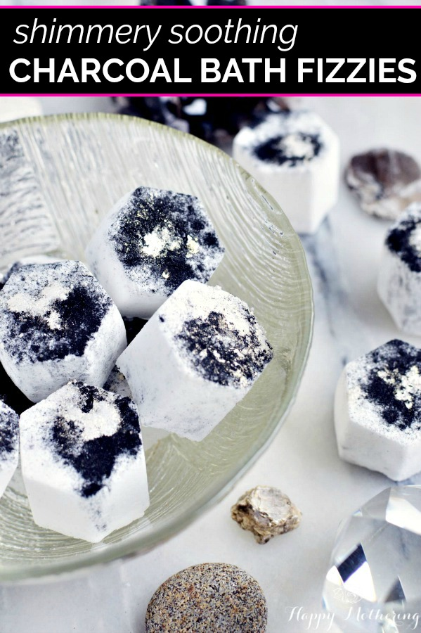 Activated charcoal is a great ingredient to add for healthy skin detoxing. Making your own DIY soothing charcoal bath fizzies with natural ingredients is easy! And they're so pretty too!