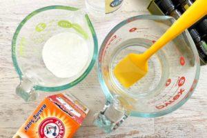Measuring baking soda into a measuring cup