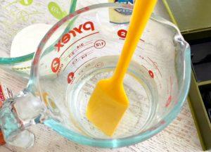 Stir essential oils into the vinegar