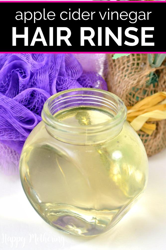 Apple cider vinegar hair rinse in a glass jar by a purple sponge and burlap packaging