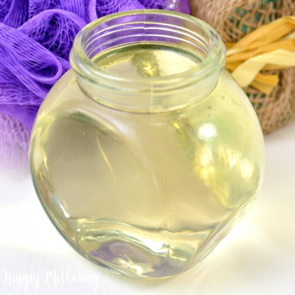 Close up of apple cider vinegar hair rinse with essential oils in a jar