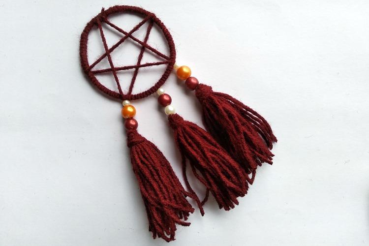 Three tassels attached to dreamcatcher pendant.