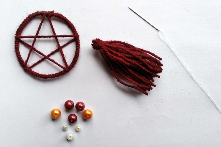 Star hoop, tassel, beads and needle with thread to make dreamcatcher necklace