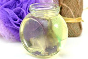 Glass jar of homemade natural hair rinse