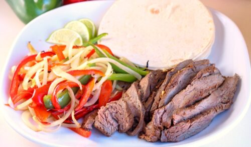 Tender steak fajitas on a plate prepared via sous vide in the Instant Pot