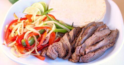 Tender steak fajitas on a plate prepared via sous vide in the Instant Pot