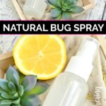 Two bottles of homemade essential oil bug spray laid in wood crates