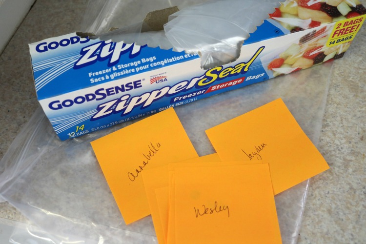 Plastic bags and sticky notes with names on them.