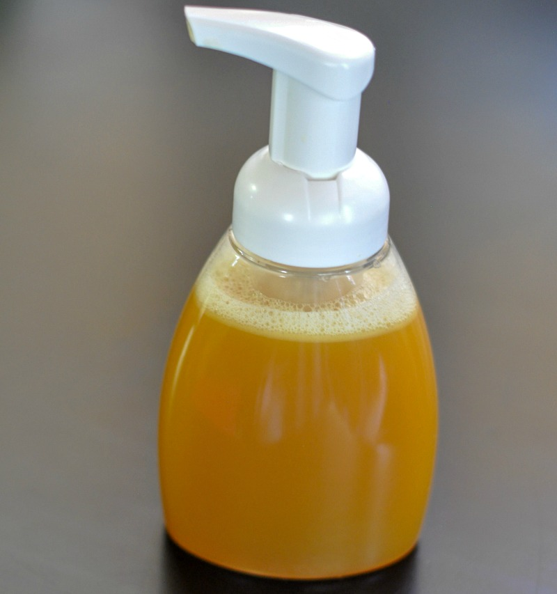 Honey Tea Face Wash on a dark brown wood table