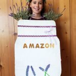 Isn't this Mason Jar Flower Vase costume absolutely adorable? Now you can be your favorite Pinterest project for Halloween! It's a simple project made from leftover Amazon smile boxes. Learn how we made this adorable boxtume that's perfect for girl, women, moms and anyone else who loves pretty costumes!