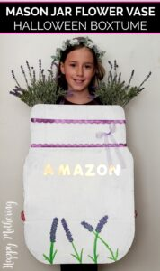 Zoe as a mason jar vase full of lavender flowers for Halloween in a DIY costume