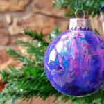 There are so many ways to make melted crayon Christmas ornaments. Learn how to make a really cool Galaxy Ornament with melted crayon in this tutorial.