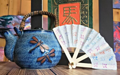 Chinese fan with tea kettle