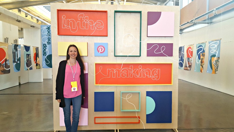 Chrystal Johnson of Happy Mothering at the Pinterest In the Making Conference in front of the conference sign.