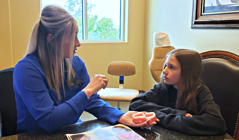Zoe learning more about Invisalign at Hoff Orthodontics