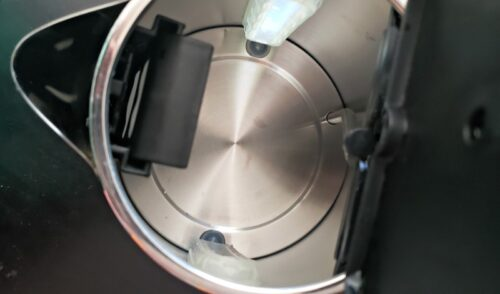 Inside view of clean electric stainless steel tea kettle after being cleaned
