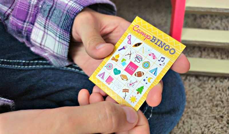 Kaylee holding the Camp Bingo game from the Camp American Girl Hangout set.